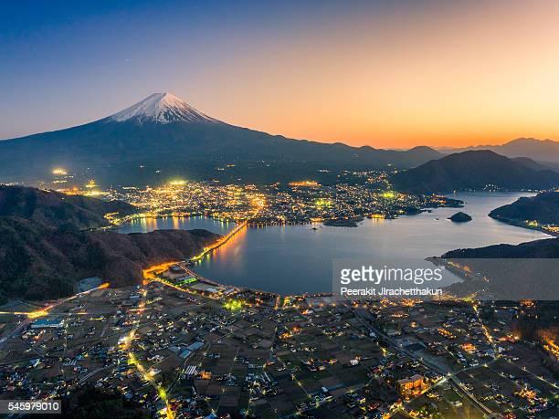 high angle view of fuji over kawaguchiko lake and city - mt. fuji stock pictures, royalty-free photos & images