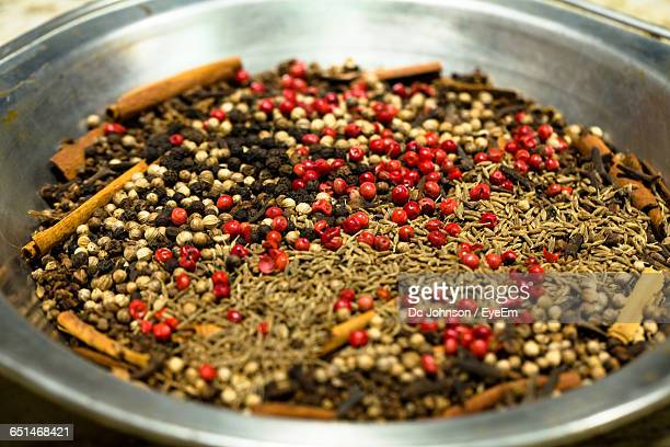 high angle view of garam masala in container - garam masala stock photos and pictures
