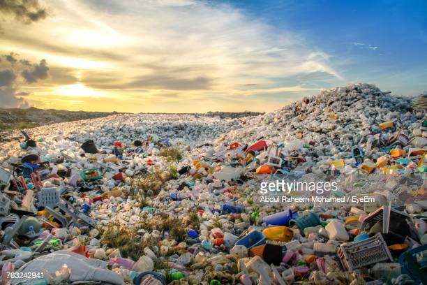 high angle view of garbage at dumping ground - plastic stockfoto's en -beelden