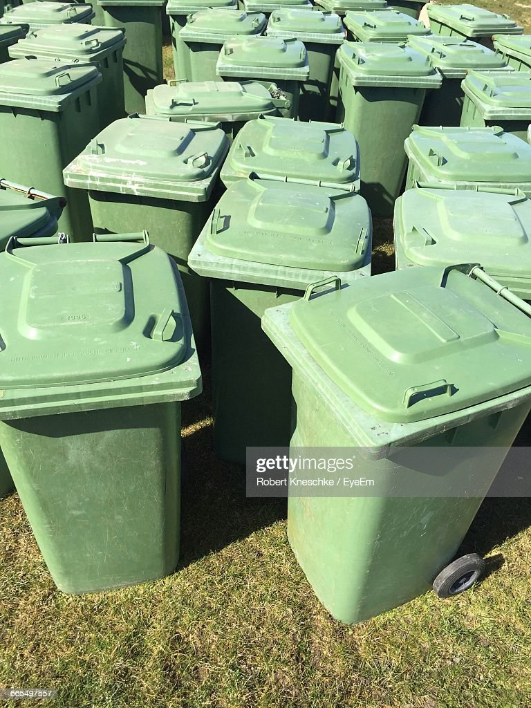 High Angle View Of Garbage Cans On Field : Stock Photo