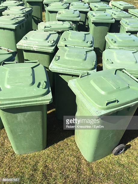 High Angle View Of Garbage Cans On Field