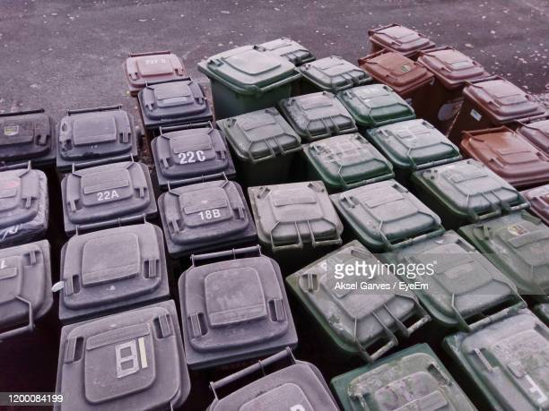 high angle view of garbage cans - aksel garves stock-fotos und bilder