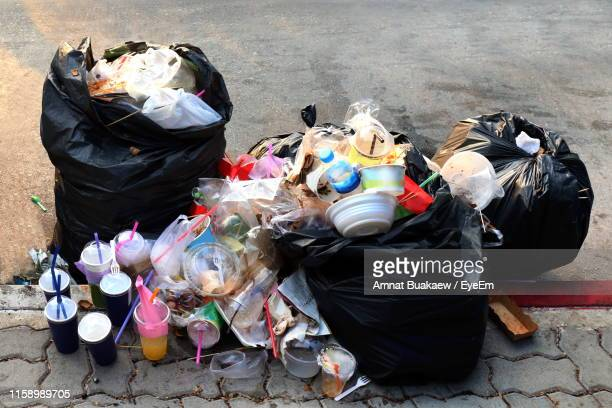 high angle view of garbage dump on street - garbage dump stock pictures, royalty-free photos & images