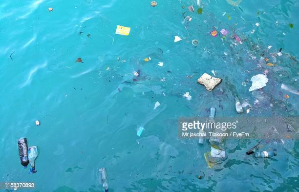 high angle view of garbage floating on water - 水質汚染 ストックフォトと画像