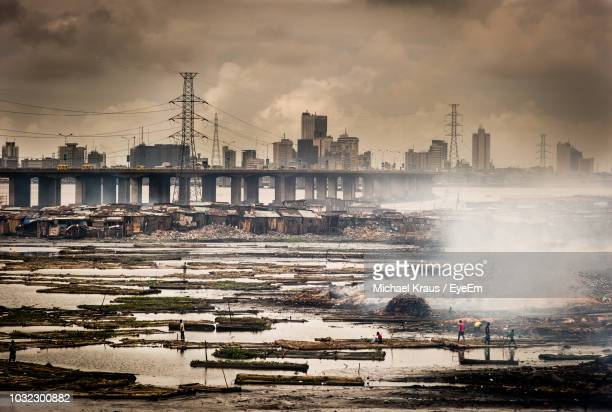 high angle view of garbage in lake against buildings - lagos nigeria stock pictures, royalty-free photos & images