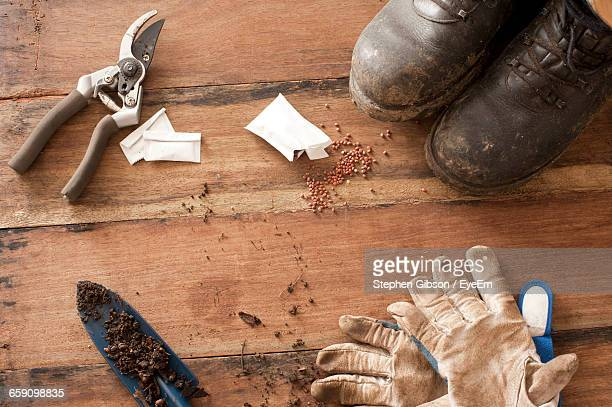 High Angle View Of Gardening Equipment On Table