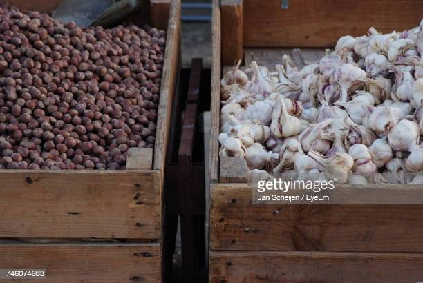 High Angle View Of Garlic And Chestnuts For Sale At Market Stall