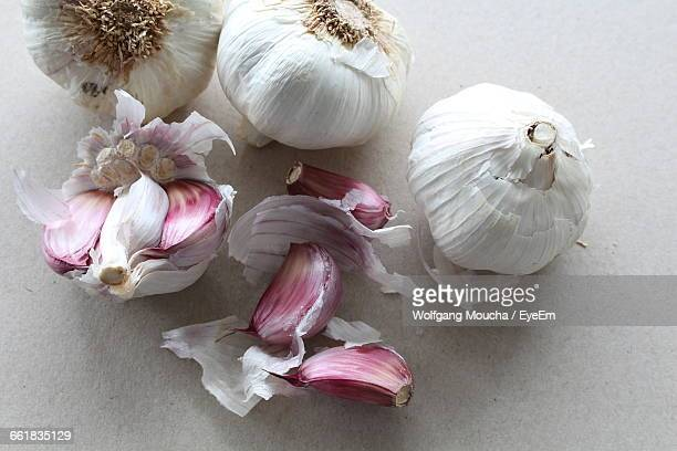 high angle view of garlic on table - garlic stock pictures, royalty-free photos & images