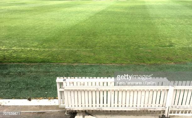 high angle view of gate by playing field - cricket field stock pictures, royalty-free photos & images