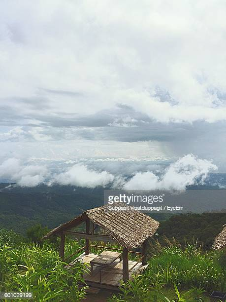High Angle View Of Gazebo On Mountain Against Cloudy Sky