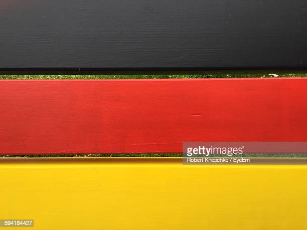 High Angle View Of German Flag Painted On Wooden Bench