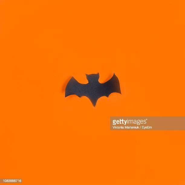 high angle view of gift with heart shapes on wooden table - batman e robin foto e immagini stock