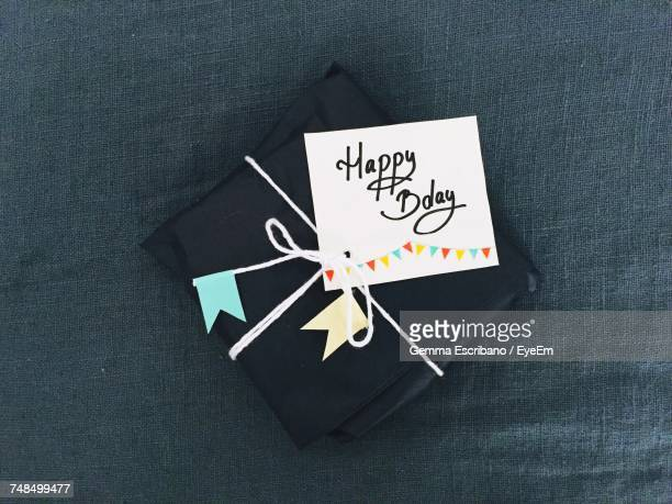 High Angle View Of Gift With Text Happy Birthday On Jute