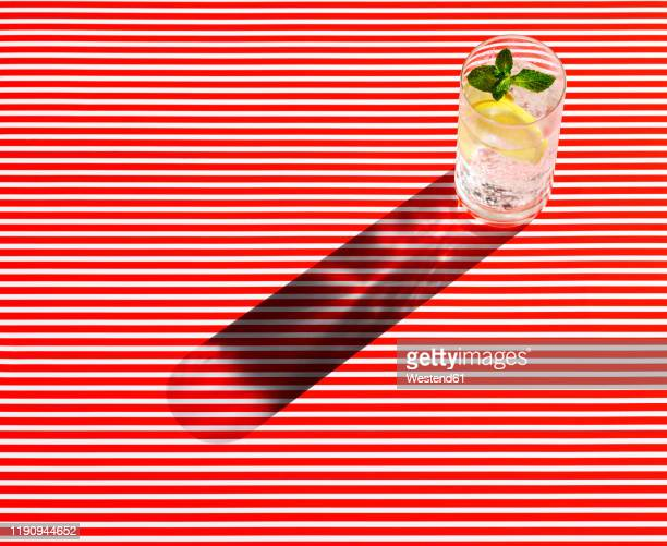 high angle view of gin served on striped table - tonic water stock pictures, royalty-free photos & images