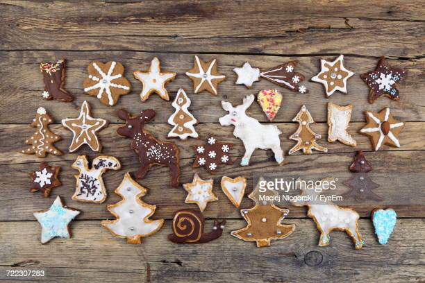 High Angle View Of Gingerbread Cookies Arranged On Wooden Table