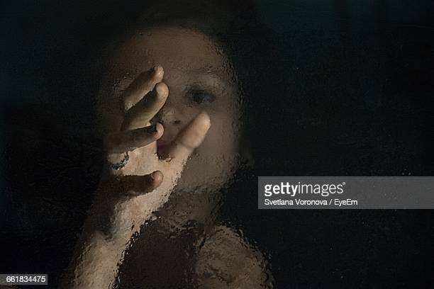 high angle view of girl emerging hand from lake - appearance stock pictures, royalty-free photos & images