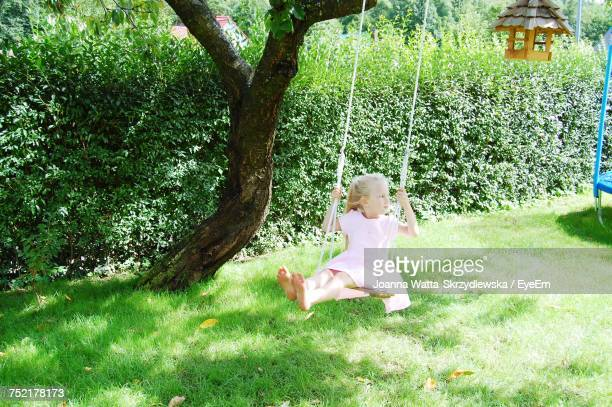 High Angle View Of Girl Enjoying On Swing At Park