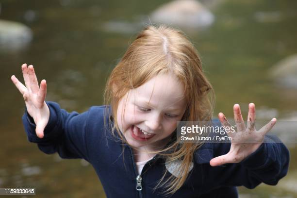high angle view of girl gesturing against lake - hutton stock photos and pictures