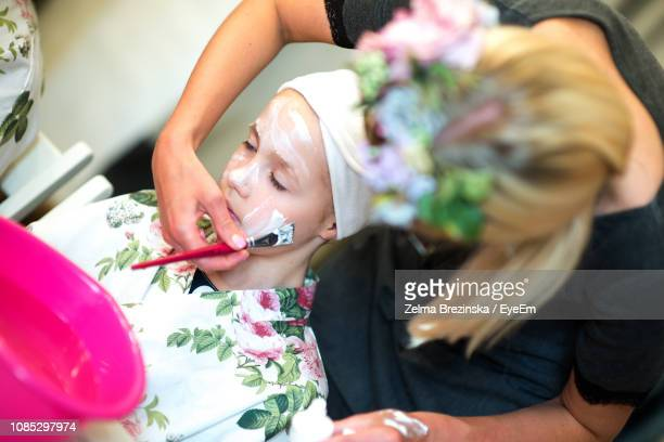 High Angle View Of Girl Getting Facial For Birthday