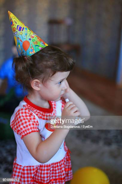 High Angle View Of Girl Wearing Party Hat While Looking Away