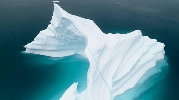 High angle view of glacier in sea