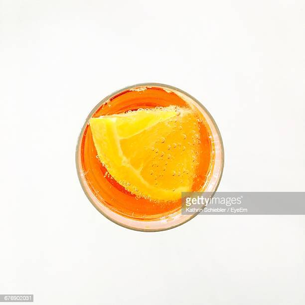 High Angle View Of Glass Of Drink With Lemon Slice