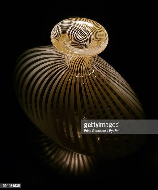 High Angle View Of Glass Vase Against Black Background