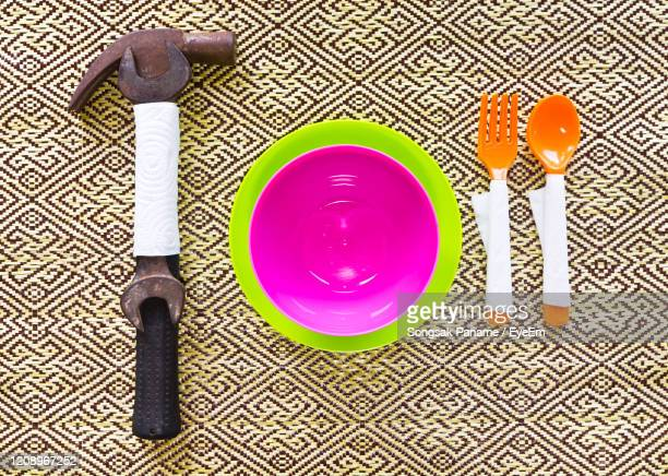 high angle view of glasses on table - plastic plate stock pictures, royalty-free photos & images