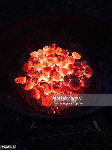High Angle View Of Glowing Coals On Barbeque
