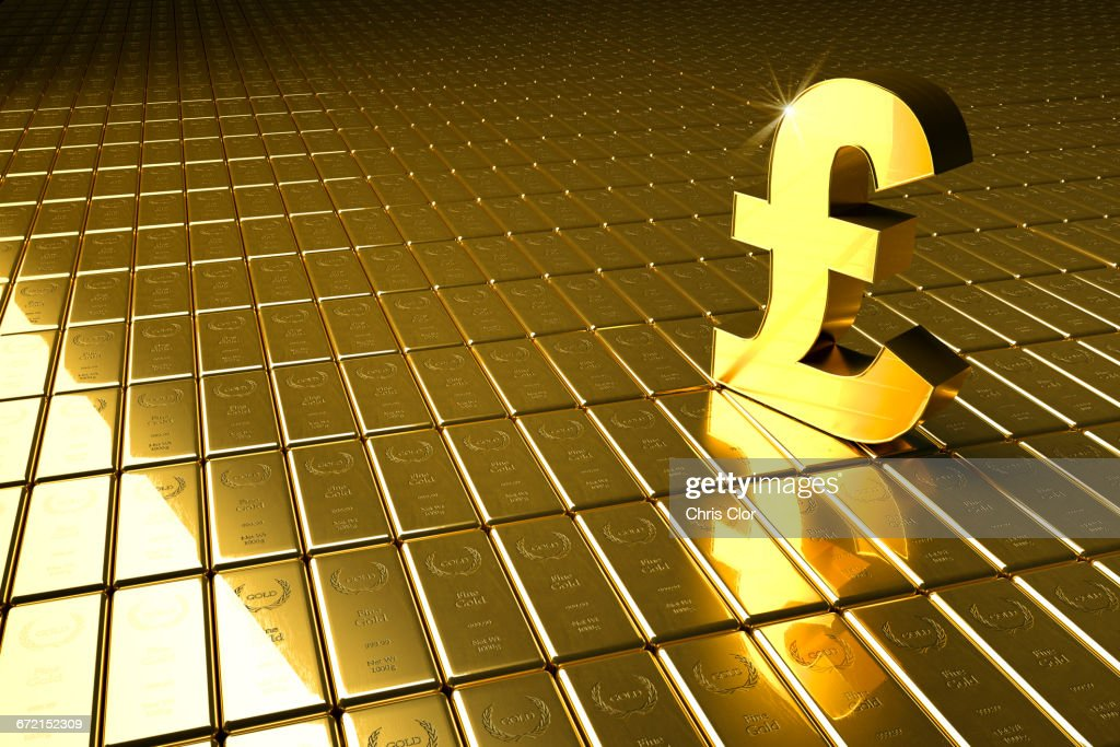 High Angle View Of Gold Bars And British Pound Symbol Stock Photo