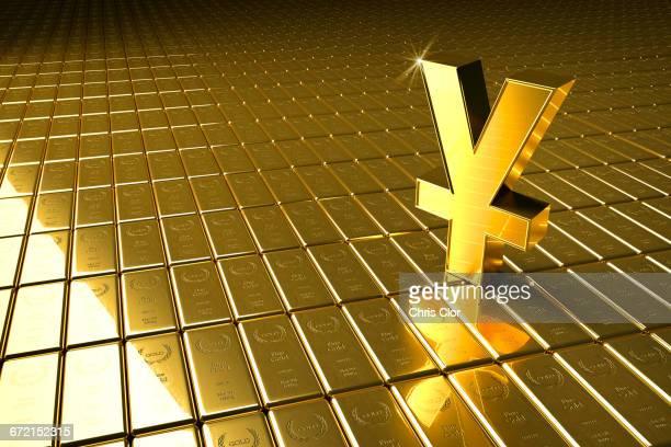 High angle view of gold bars and yuan symbol