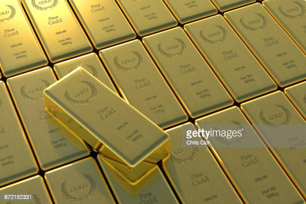 High angle view of gold bars and yuan symbol