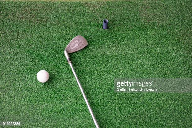 high angle view of golf ball and iron on driving range - driving range stock pictures, royalty-free photos & images
