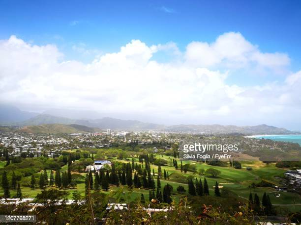 high angle view of golf course club against sky - kailua stock pictures, royalty-free photos & images