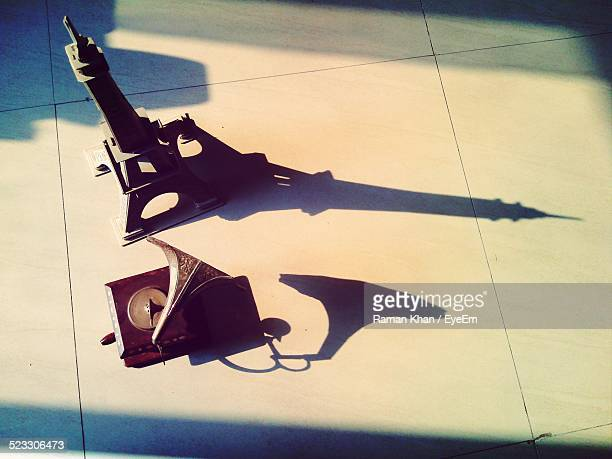 High Angle View Of Gramophone And Replica Of Eiffel Tower At Home