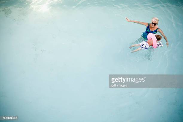 High angle view of grandmother and child in water