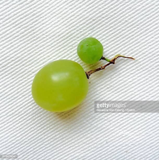 High Angle View Of Grapes On White Fabric