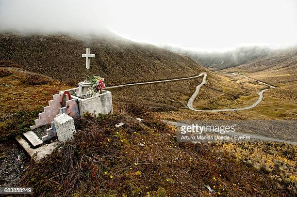 High Angle View Of Grave Against Remote Landscape