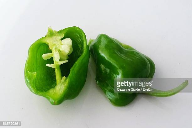 High Angle View Of Green Bell Pepper Over White Background