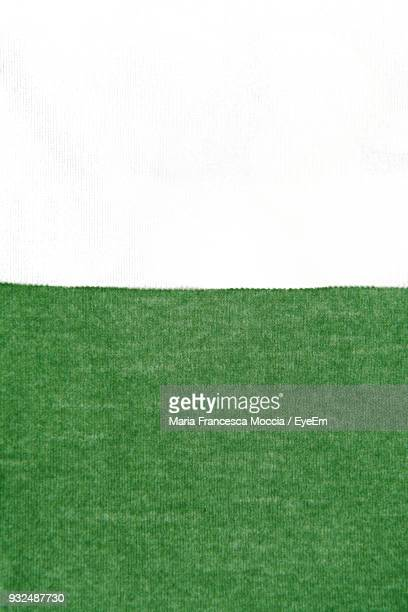High Angle View Of Green Fabric On White Background