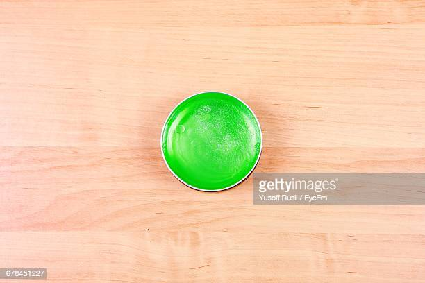 High Angle View Of Green Hair Gel On Table