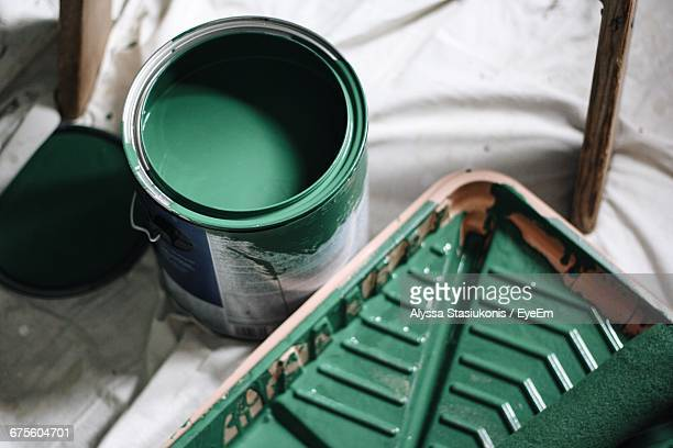 high angle view of green paint can at home - paint roller stock pictures, royalty-free photos & images