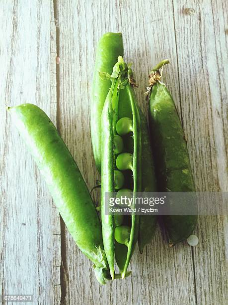 High Angle View Of Green Peas On Wooden Table