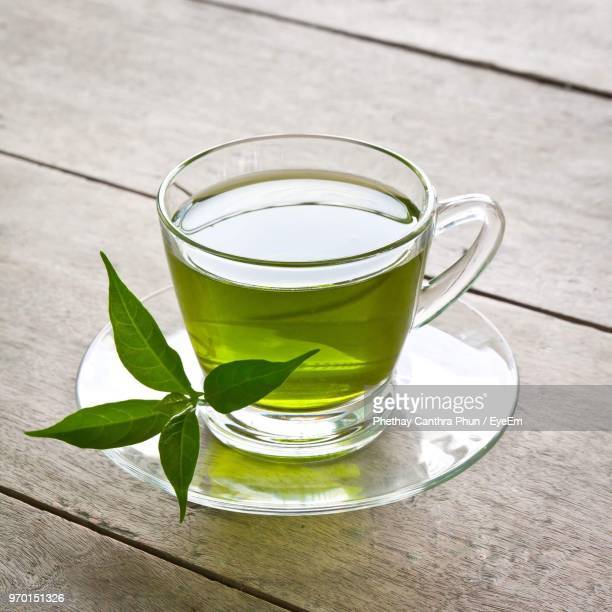high angle view of green tea in cup - saucer stock pictures, royalty-free photos & images