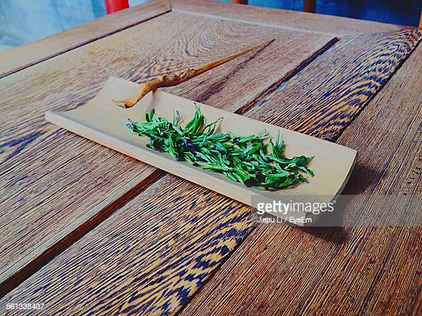 High Angle View Of Green Tea Leaves On Table