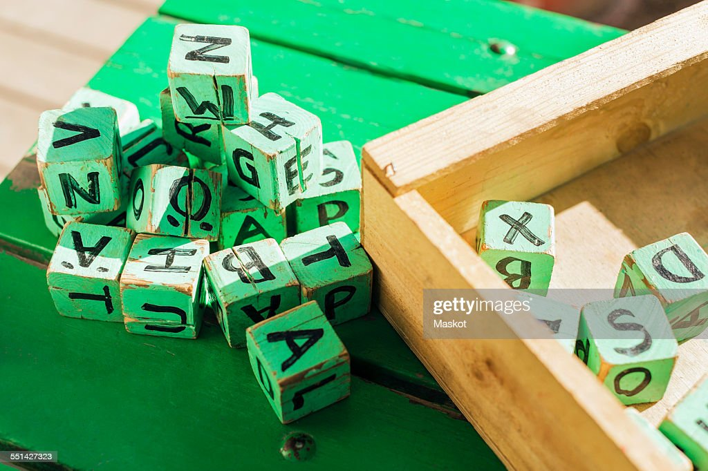 High angle view of green wooden blocks on table outside kindergarten : Stock Photo