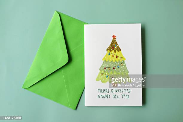high angle view of greeting card on green background - greeting card stock pictures, royalty-free photos & images