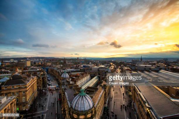 high angle view of grey street amidst city against cloudy sky during sunset - newcastle upon tyne stock pictures, royalty-free photos & images