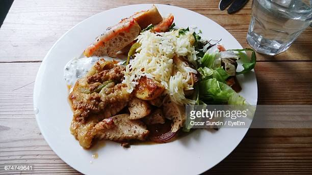 High Angle View Of Grilled Chicken With Rice And Vegetables