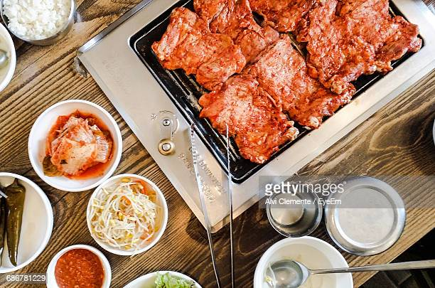 High Angle View Of Grilled Meat With Salad On Table